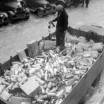 Prohibition agent stands in a flatbed of confiscated alcohol at the Trumbull Street Police Station in Detroit, Michigan