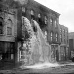 A distillery in Detroit discovered by prohibition agents who destroyed equipment, causing alcohol to pour out of windows