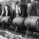 Police emptying kegs of alcohol