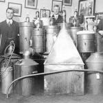 Law enforcement officers posing with stills seized in Vancouver, 1917